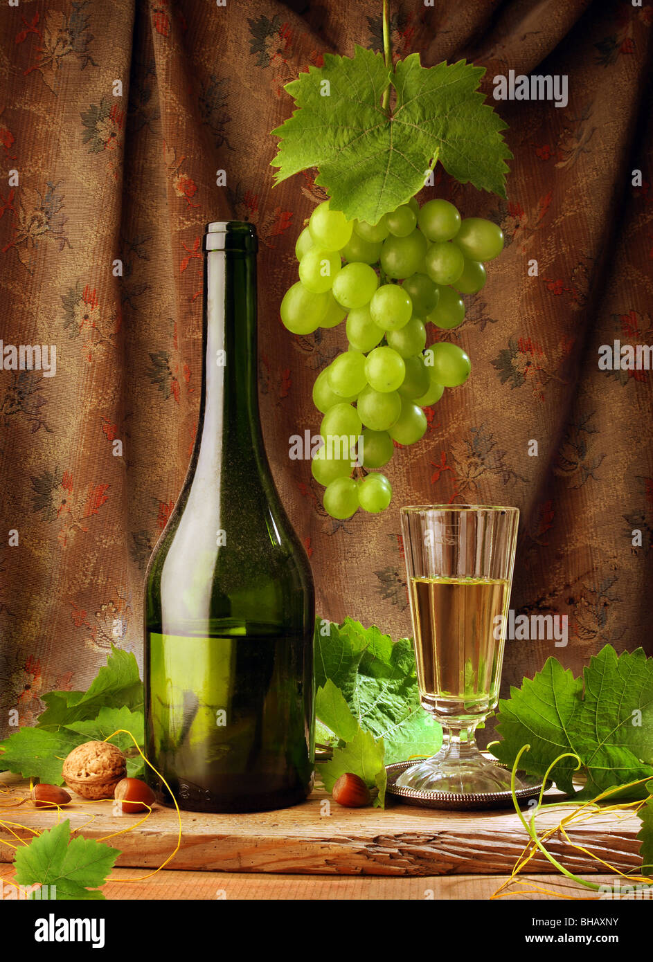 wine still life in vintage style with white wine bottle