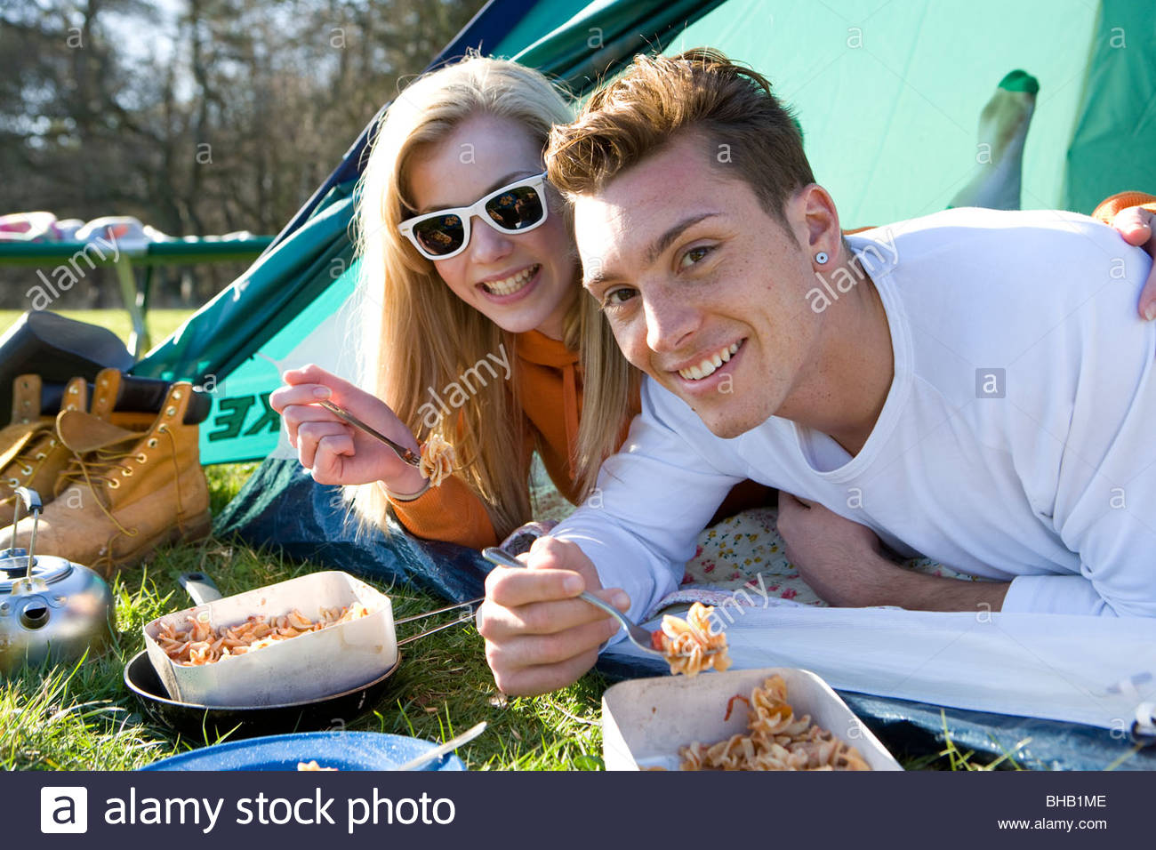 Couple eating in doorway of tent  sc 1 st  Alamy & Couple eating in doorway of tent Stock Photo Royalty Free Image ...