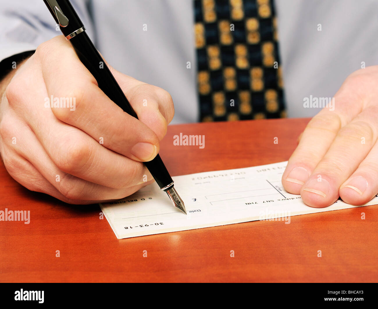 Stock Photo  Writing A Cheque