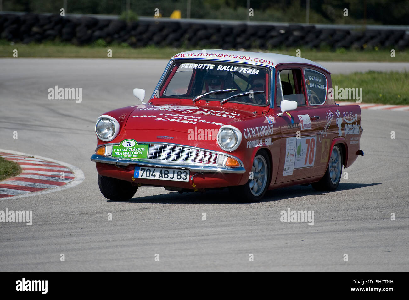 Red Ford Anglia classic car racing in a rally in Spain. & Red Ford Anglia classic car racing in a rally in Spain Stock Photo ... markmcfarlin.com