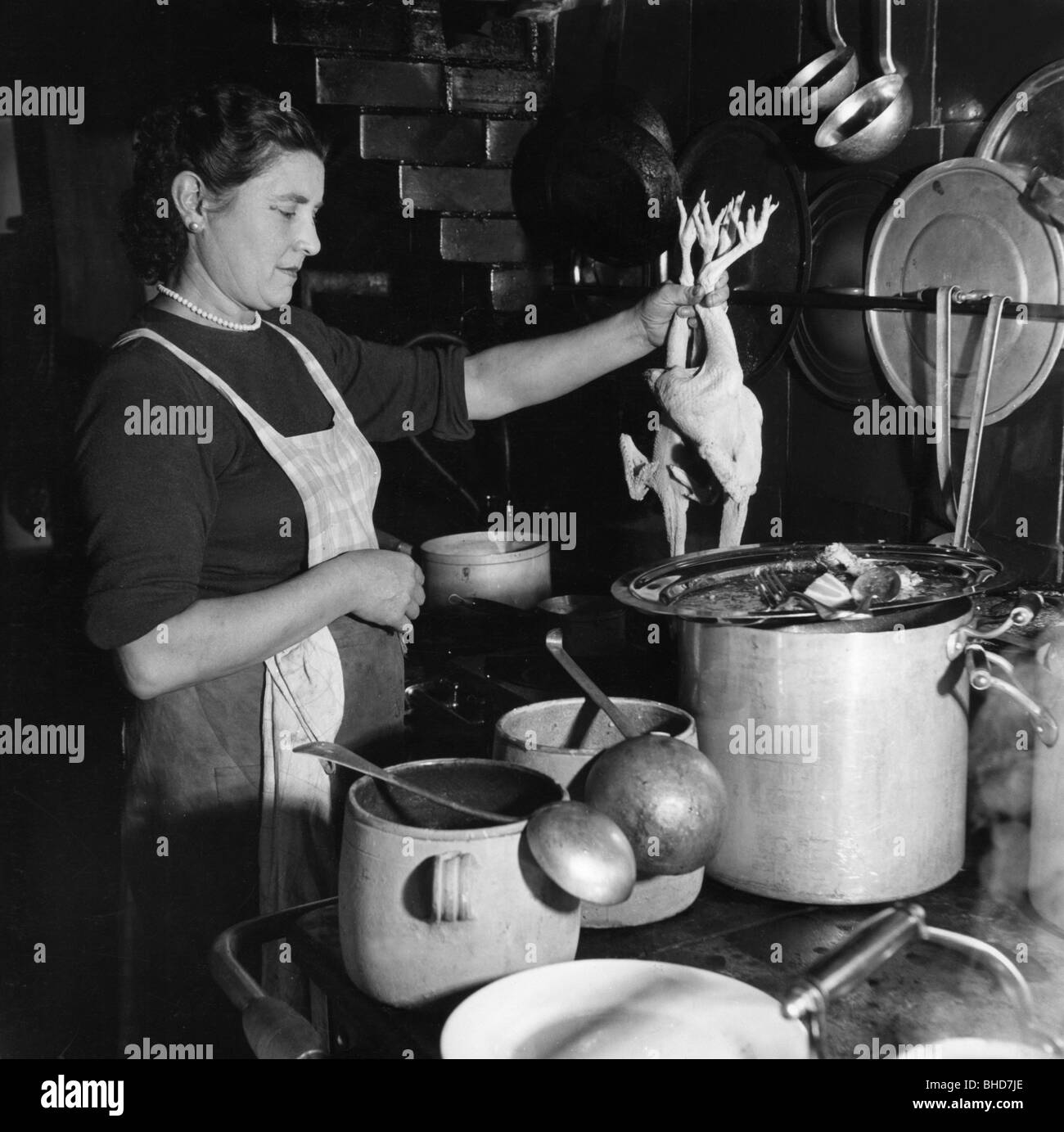 Retro Woman In Kitchen: Household, Cooking And Baking, Woman At Grill Stove, 1950s