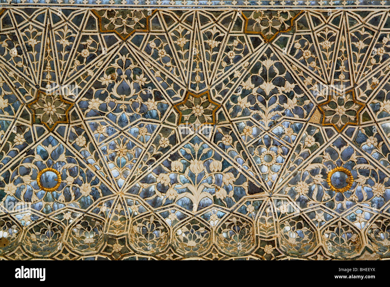 Blue and gold islamic pattern in ceiling tiles of the Tiles for hall in india
