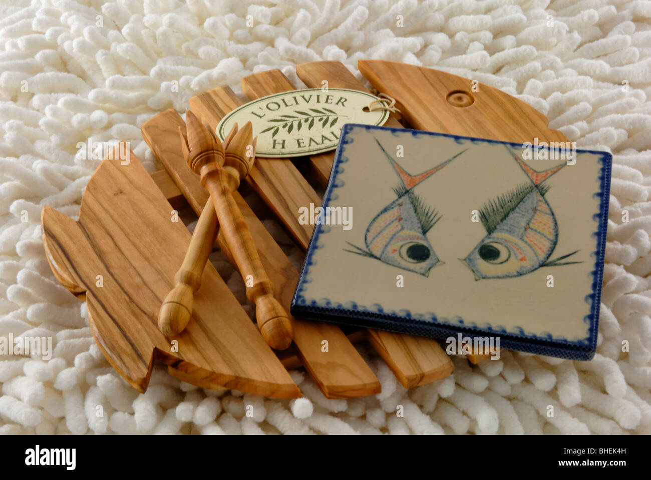 A wooden trivet two wooden olive forks and a ceramic art tile from a wooden trivet two wooden olive forks and a ceramic art tile from loliver the loliver a ceramic gallery and shop is locate dailygadgetfo Images