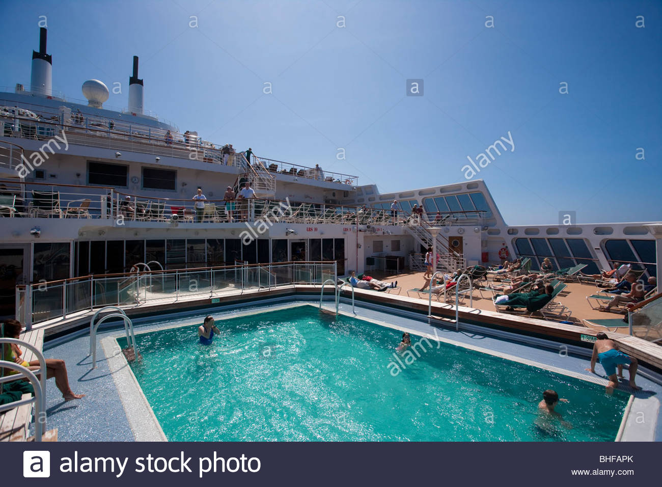 Passengers in the swimming pool and on the sun deck queen - Queen mary swimming pool victoria ...