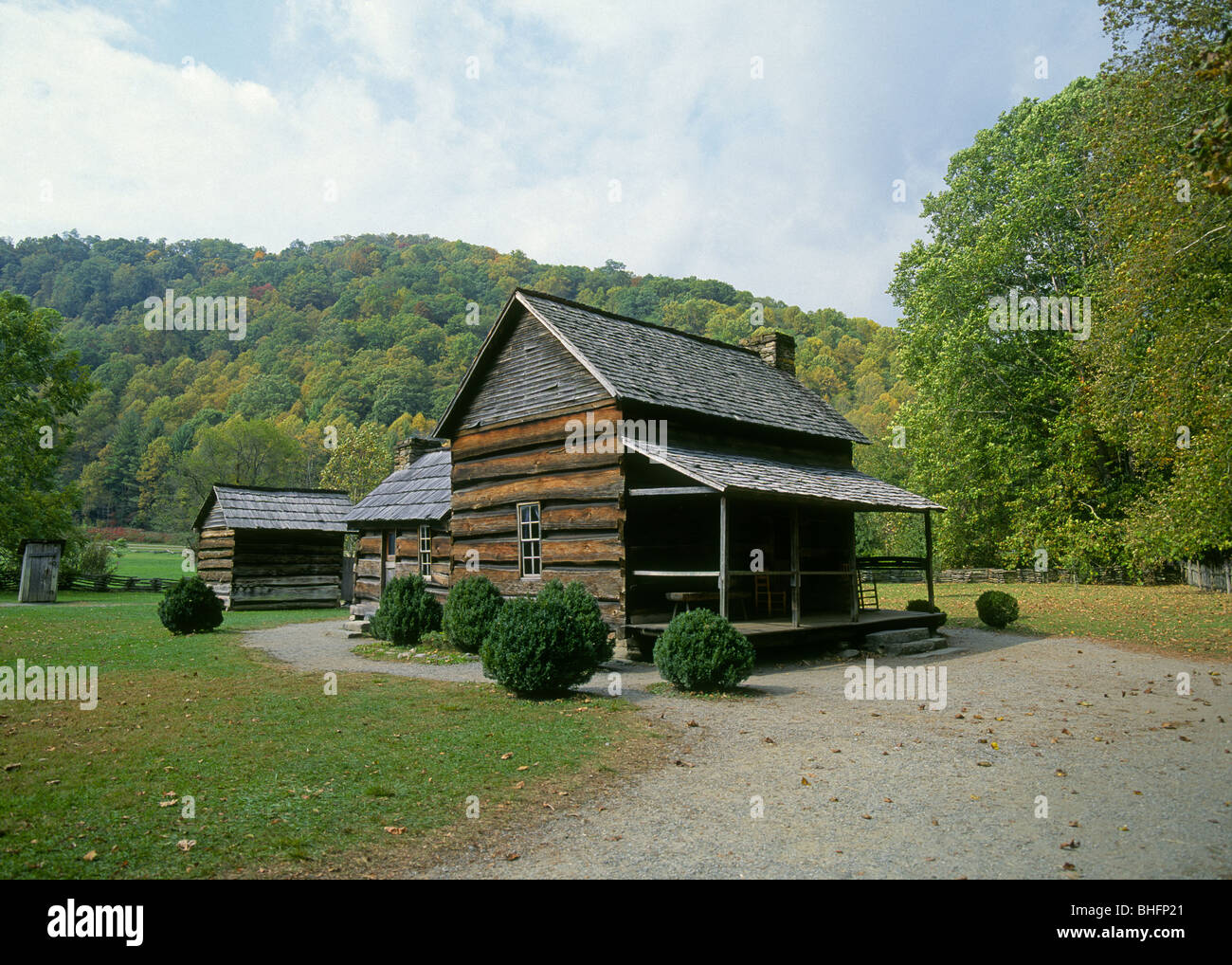 A hand hewn log cabin in the hardwood forest of the great for Cabin in north carolina mountains