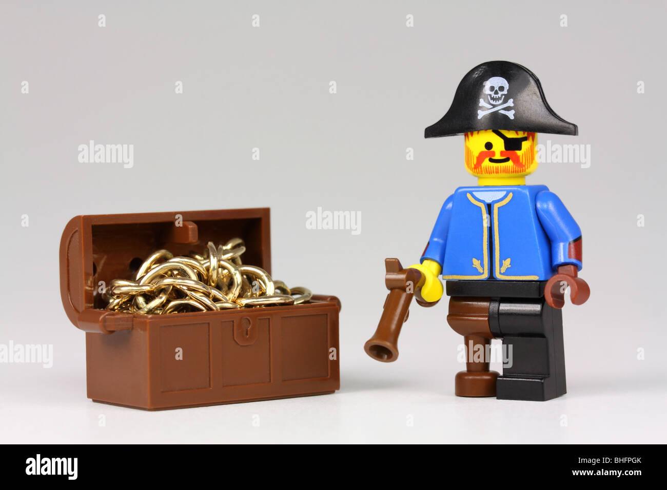 Treasure Toys Cartoon : Lego pirate and treasure chest full of gold stock photo