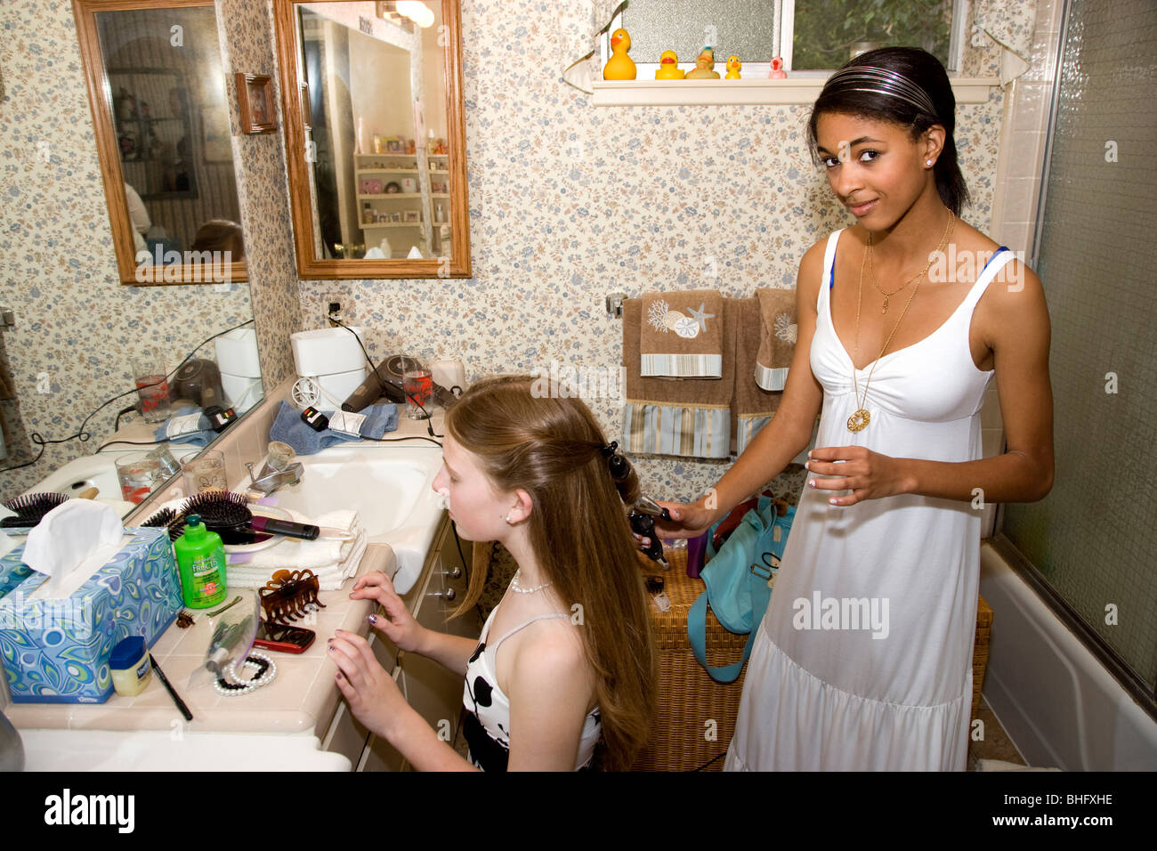 Photos of girl without any cloth in bathroom - Preparing For Their Formal Dance African American Girl Doing Her Friends Hair In The Bathroom On Her Knees