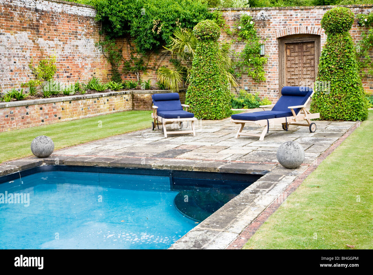 Swimming pool in a walled garden in the grounds of an for Garden city pool hours