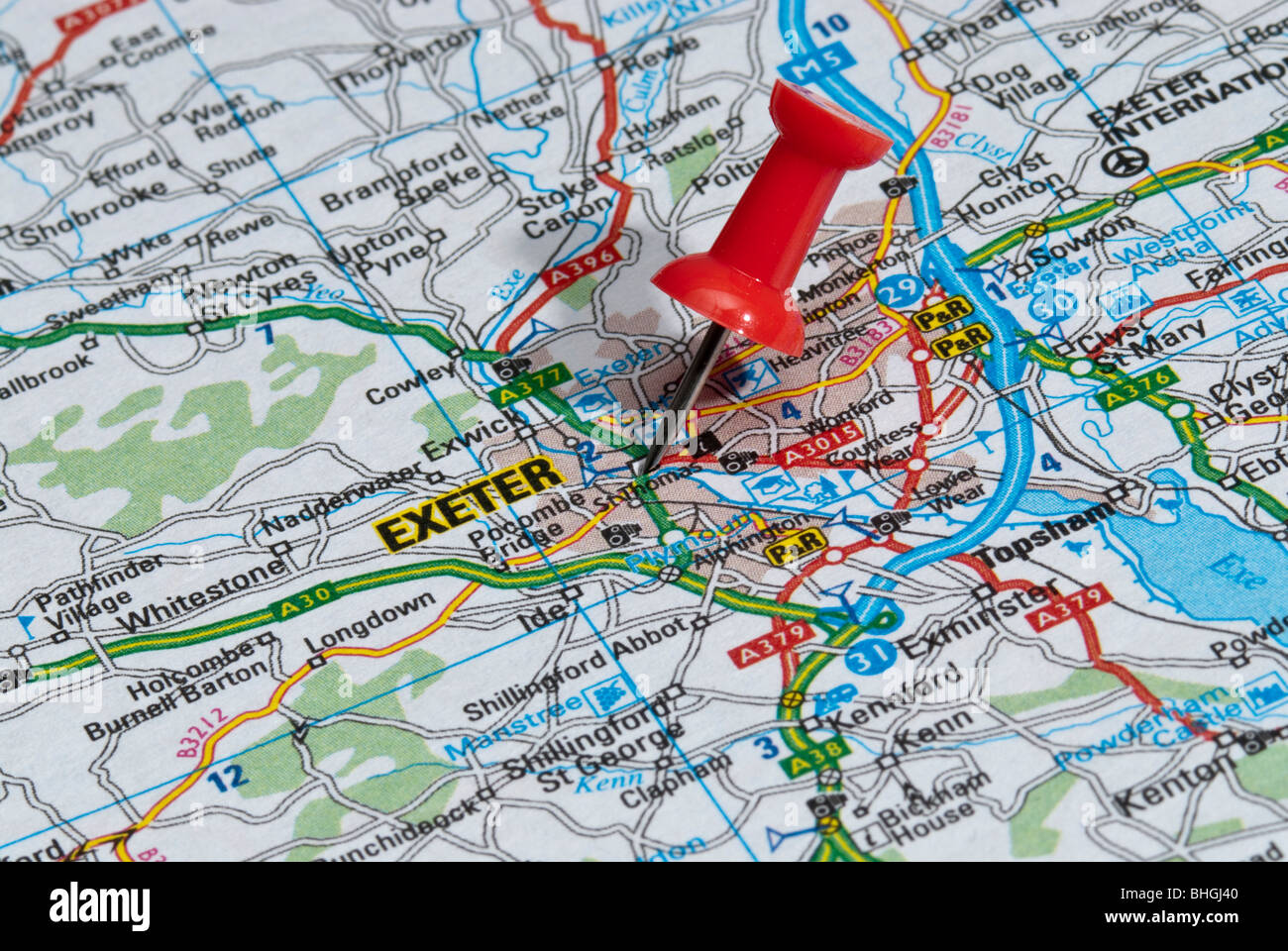 red map pin in road map pointing to city of Exeter Stock Photo