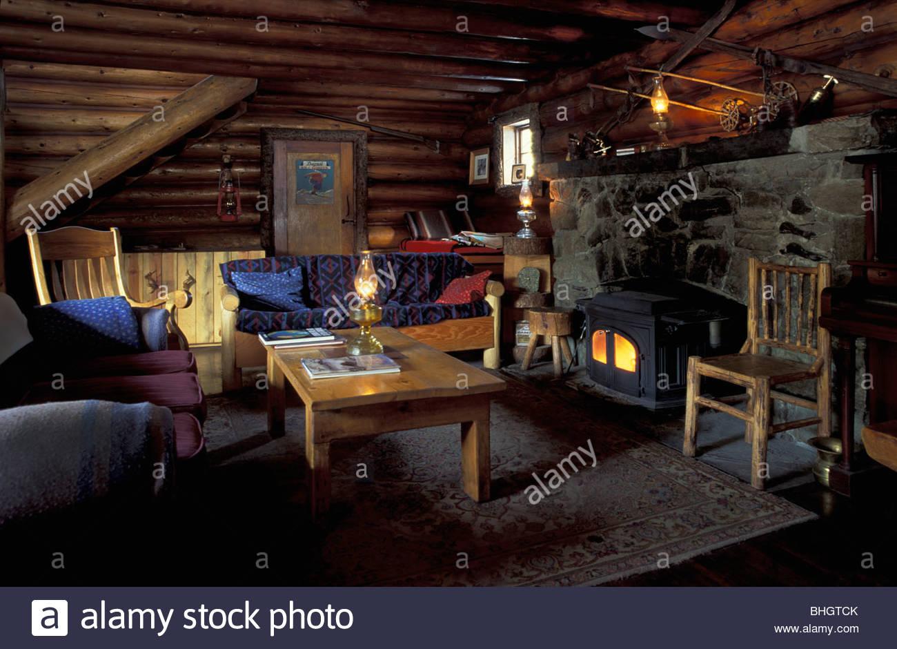 interior view of living area u0026 fireplace in skoki lodge in banff