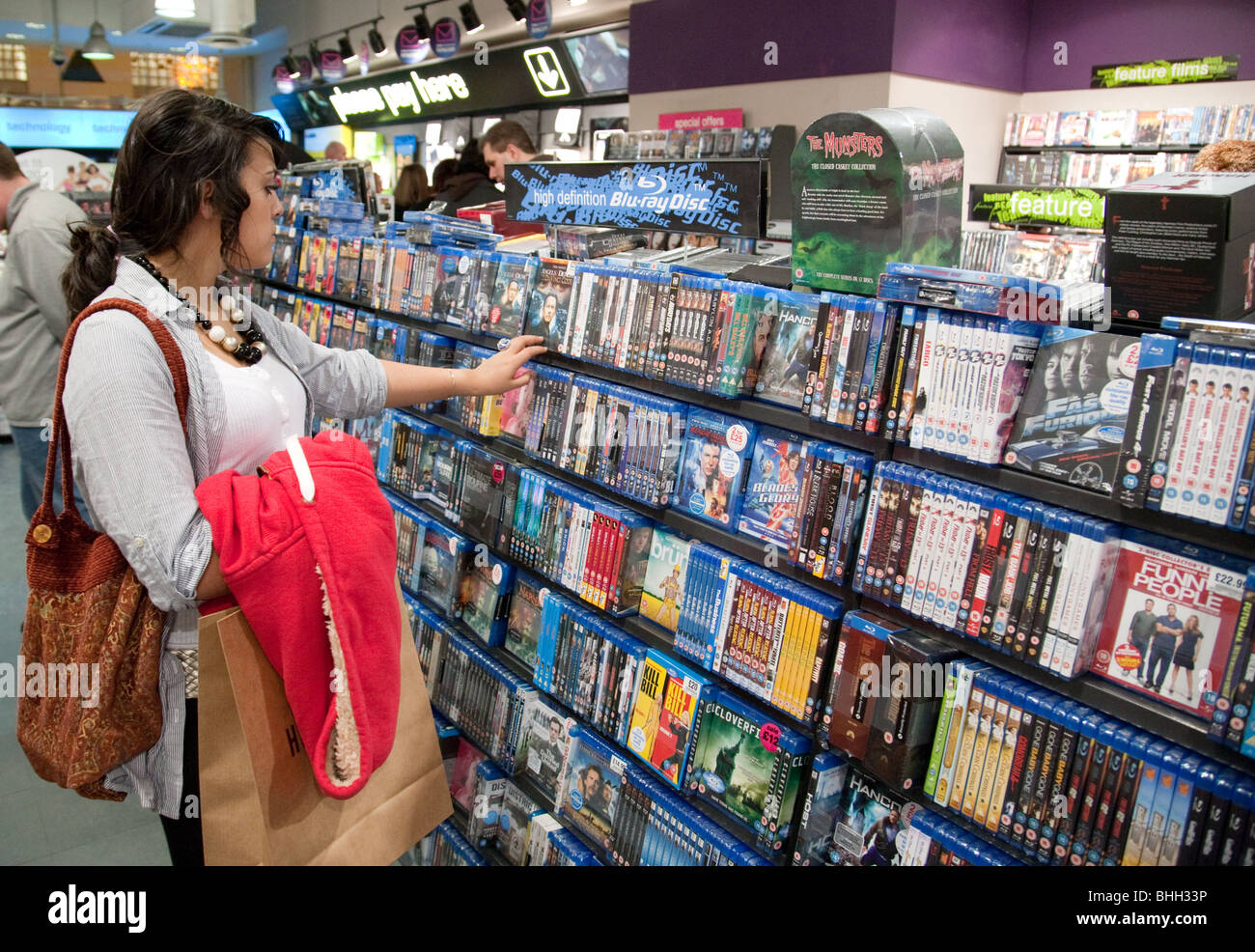 a teenage girl looking at blu ray dvd dvds interior the hmv store stock photo royalty free. Black Bedroom Furniture Sets. Home Design Ideas