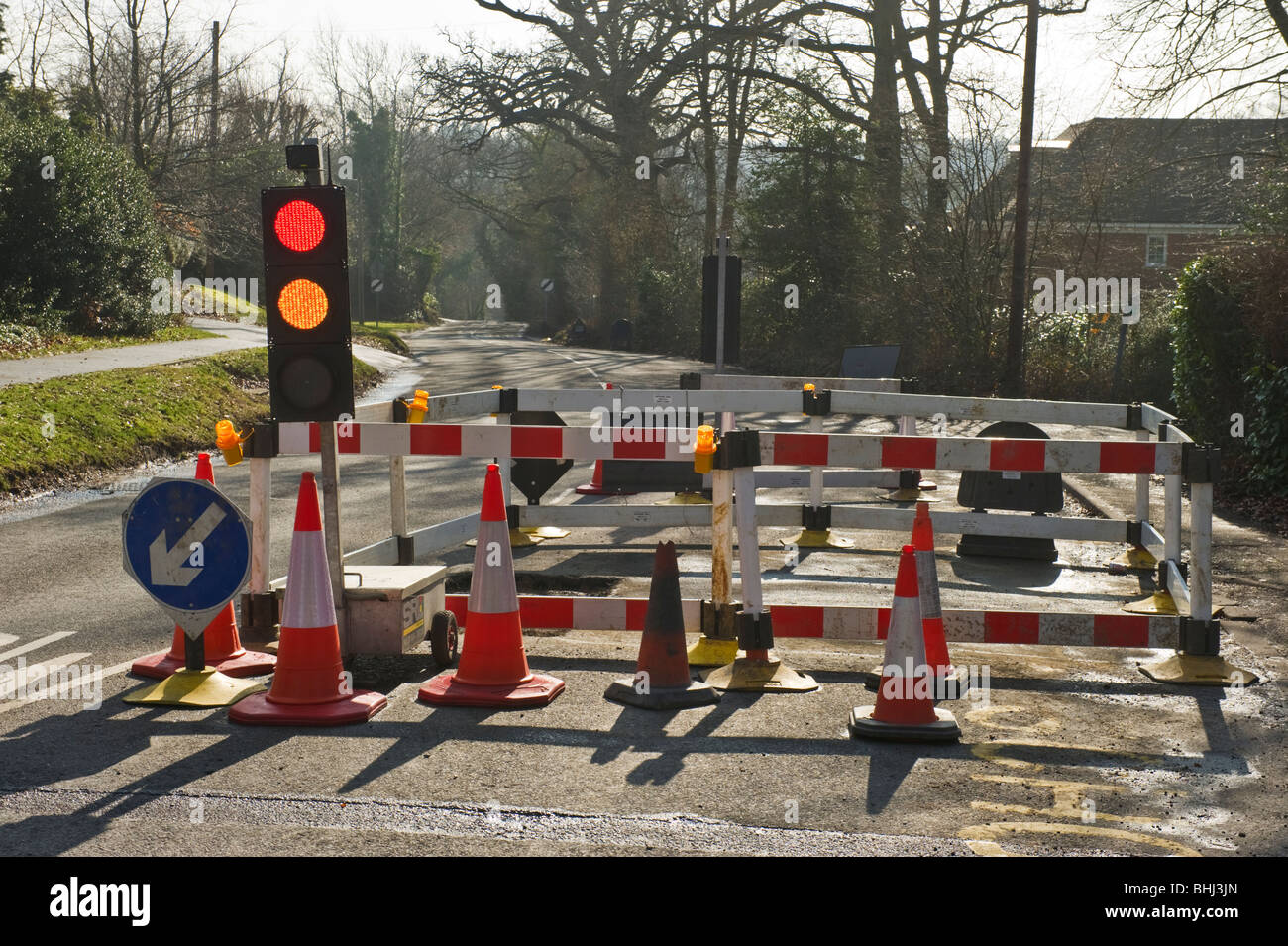 Temporary traffic lights and barriers at roadworks in seer