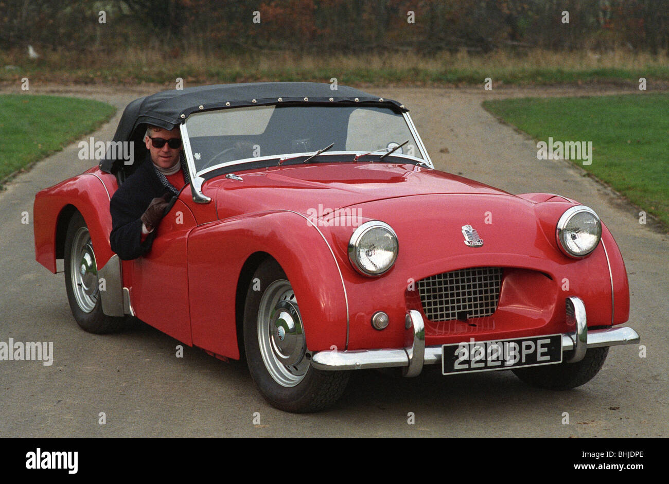 triumph tr2 red sports car classic british car male driver. Black Bedroom Furniture Sets. Home Design Ideas