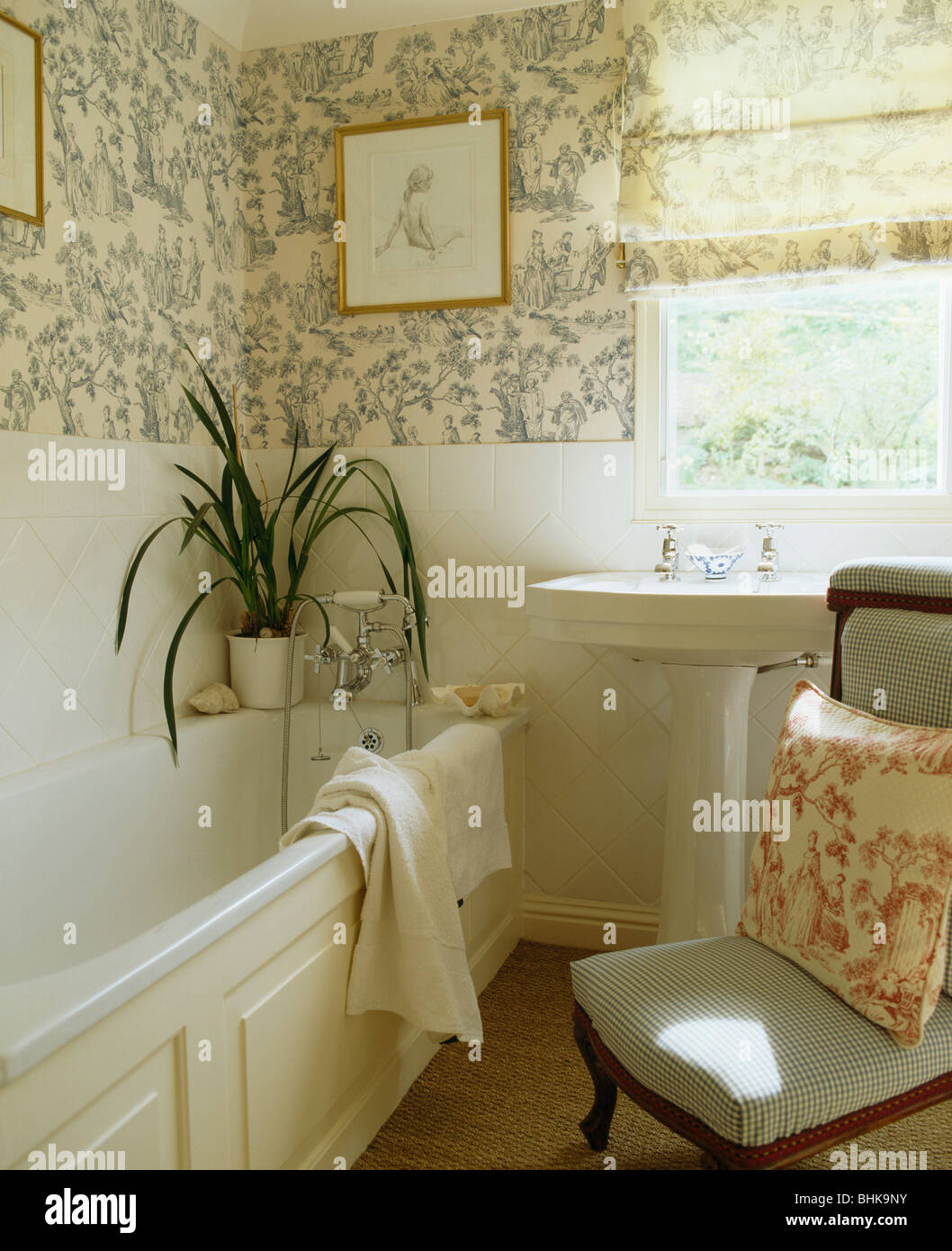Blue White Toile De Jouy Wallpaper And Blind In Small Bathroom With Houseplant On Side Of The Bath