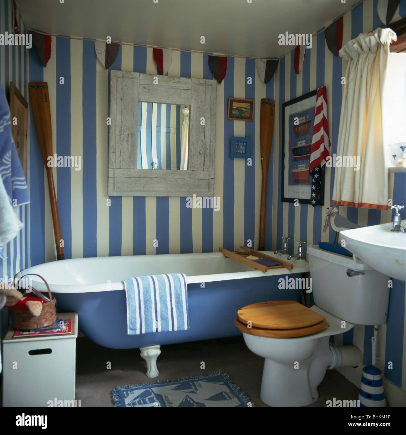 Blue cottage bathrooms -  Hand Painted Blue White Striped Walls In Cottage Bathroom With Blue Roll Top