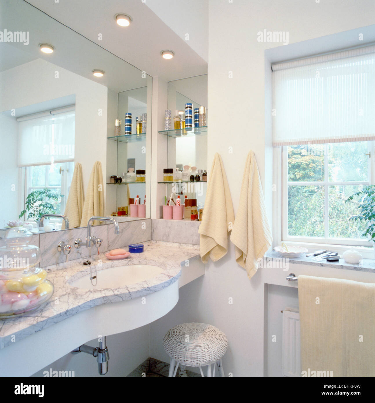 Under Set Basin In Marble Vanity Unit Below Mirror And Recessed Lighting In  Small White Bathroom With White Blind On Window