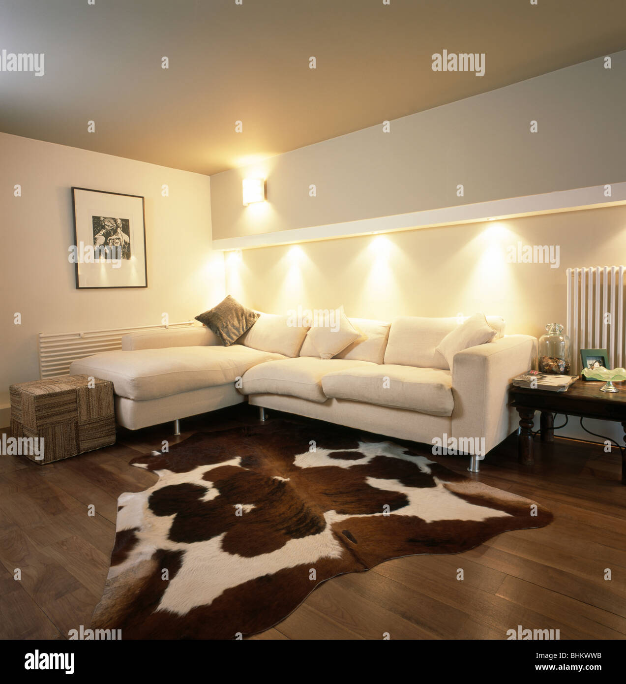 Artificial cowhide rug in modern living room with downlighting
