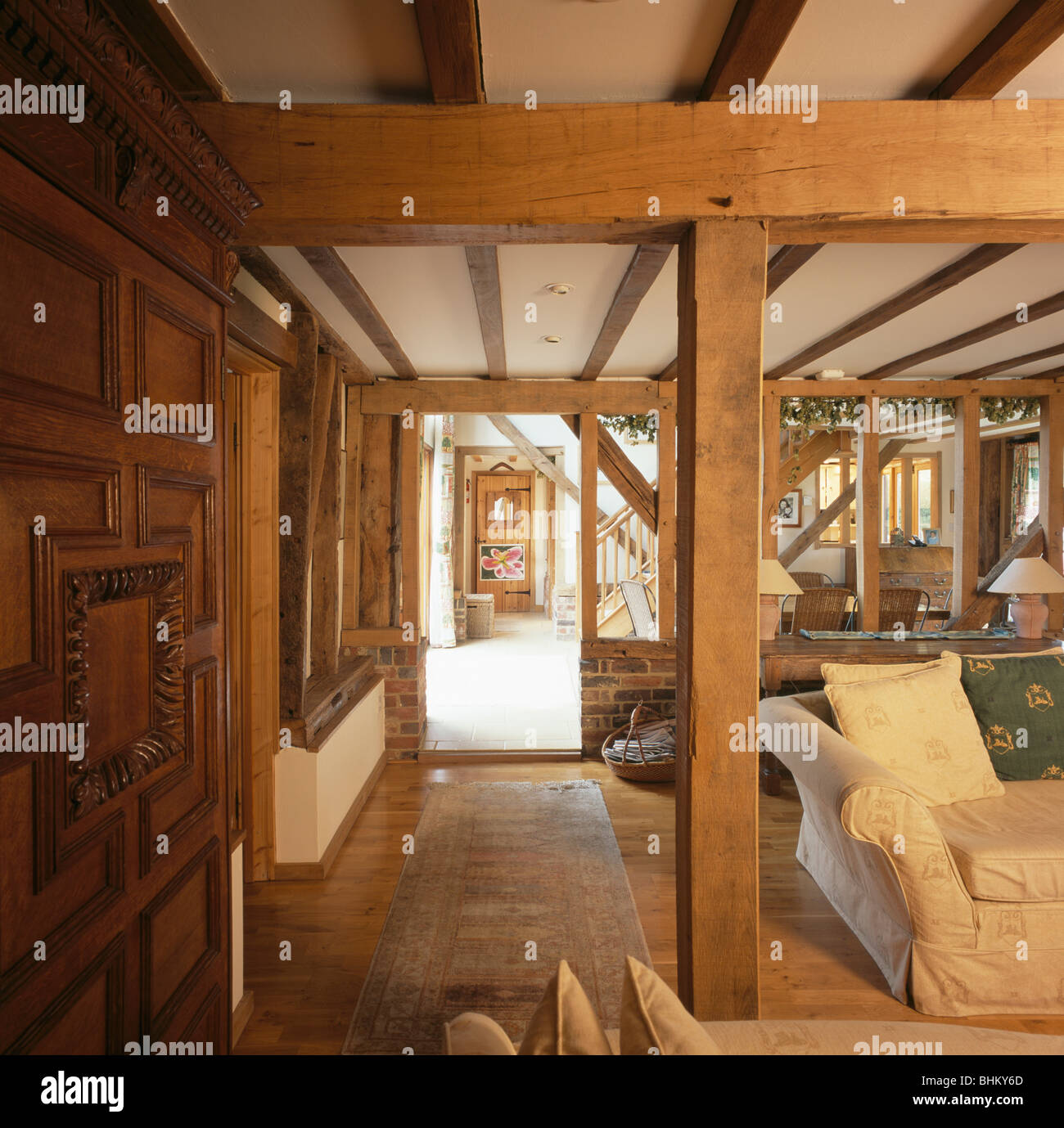 Large wooden support and ceiling beams in living room