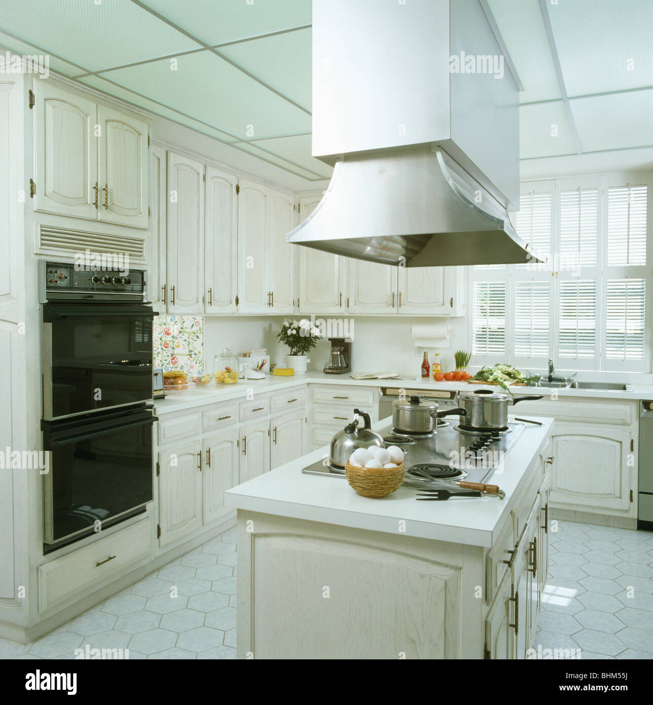 White Kitchen Extractor Fan extractor fan above hob in blue island unit in modern white