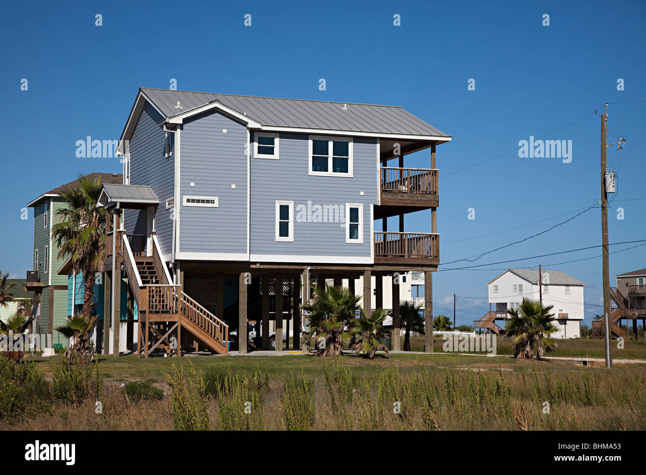 Wooden house on stilts on beach front galveston texas usa for Beach house on stilts