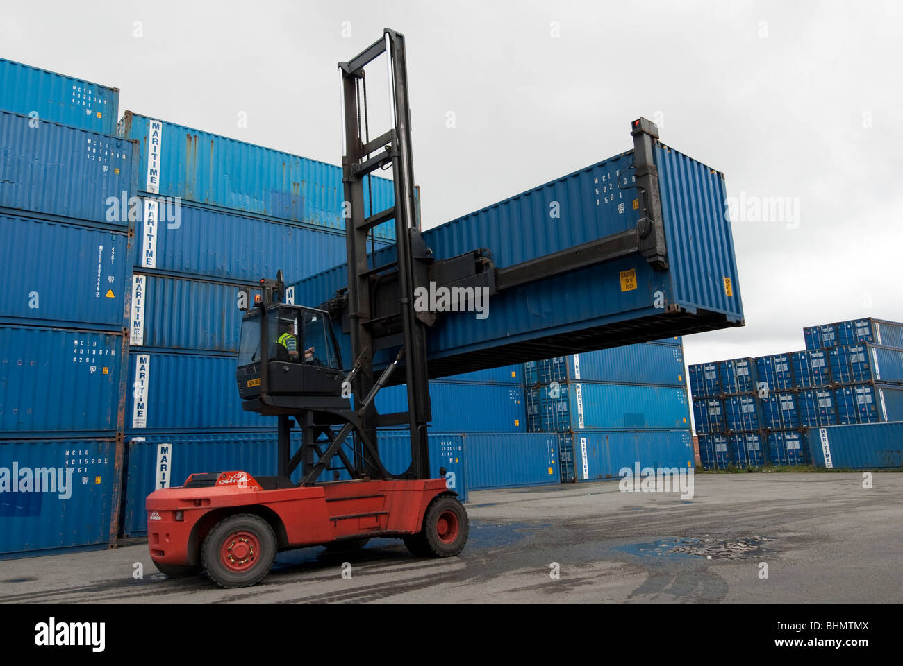 Container Moving Crane Being Used To Position Ships Containers In Storage  Yard