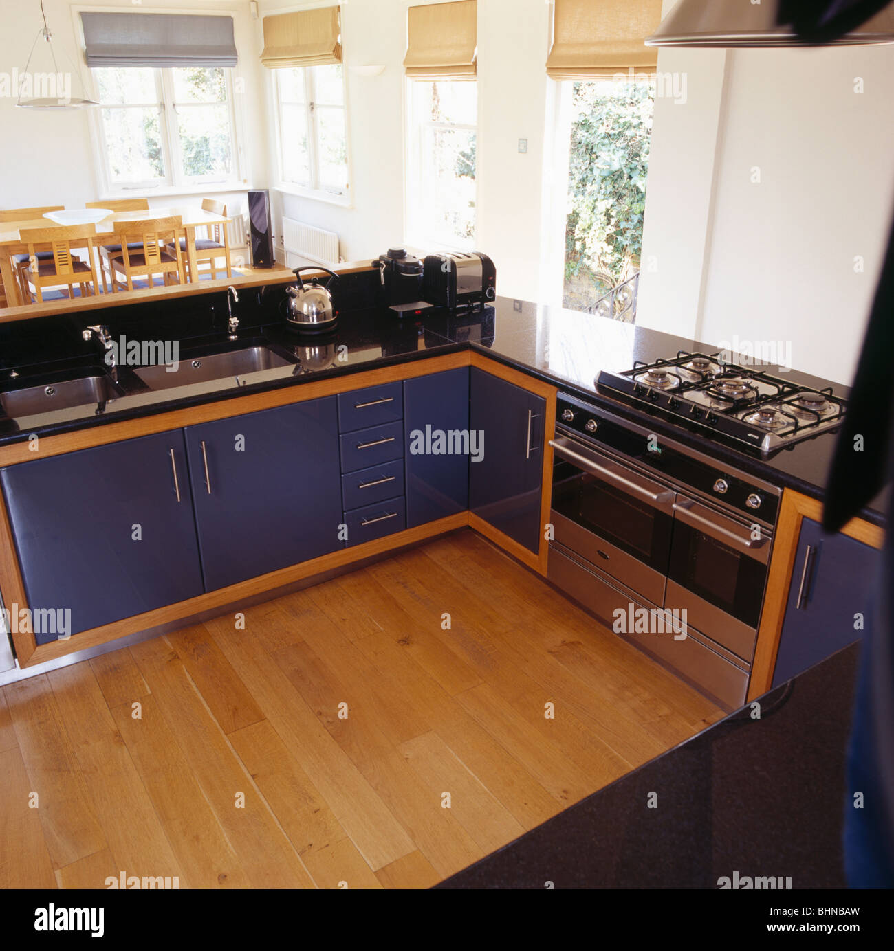 Open Oven In Kitchen: Black Fitted Units In Modern Open-plan Kitchen With Range