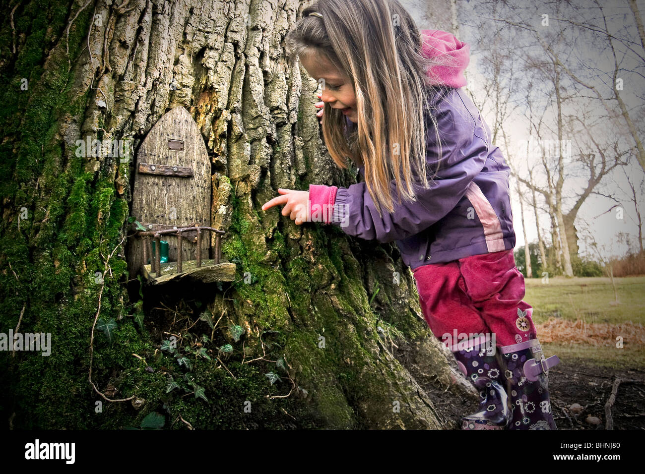 A Young Girl Discovers A Fairy Door In A Magical Woodland