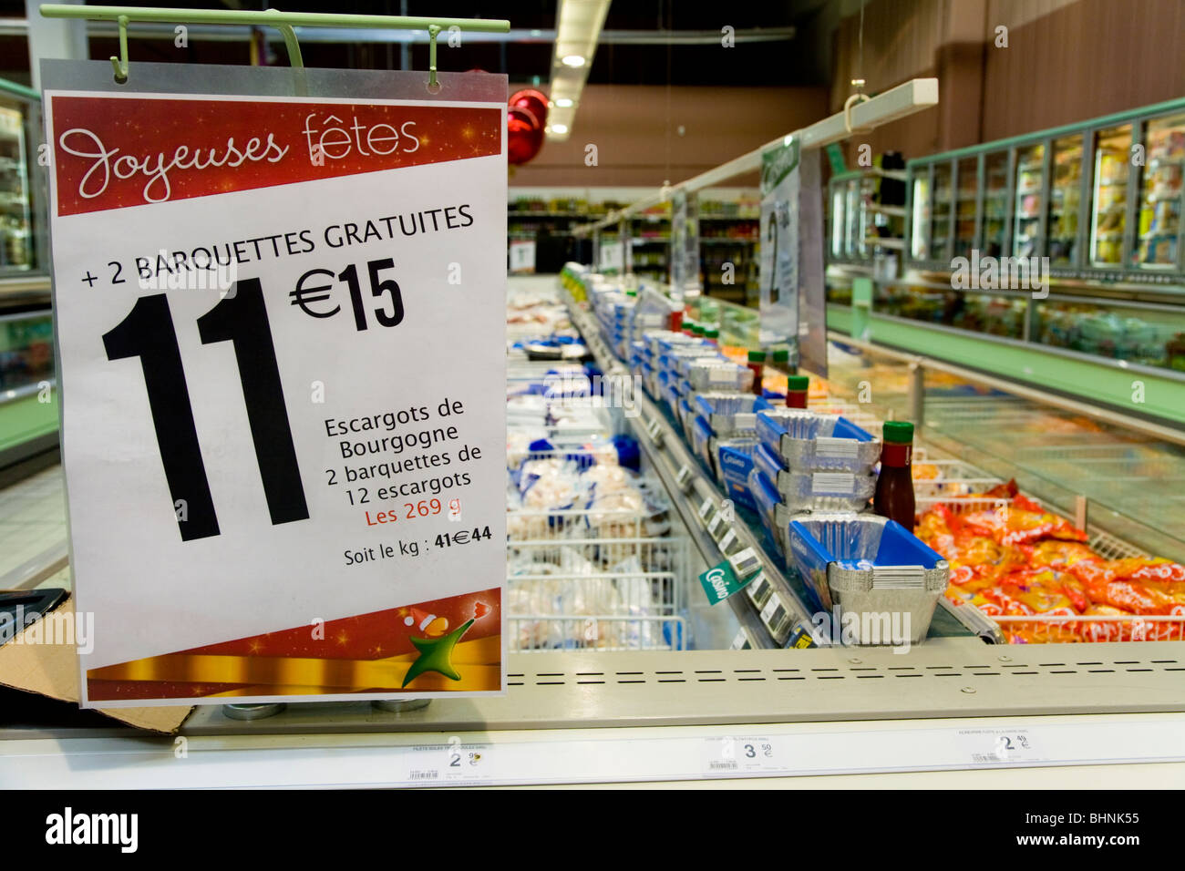 price prices point of sale sign at christmas on a row of chest freezers in a french supermarket france - Chest Freezers On Sale