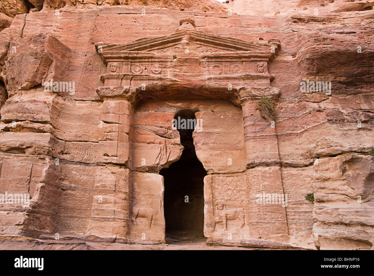 One of the many buildings carved on rock in petra