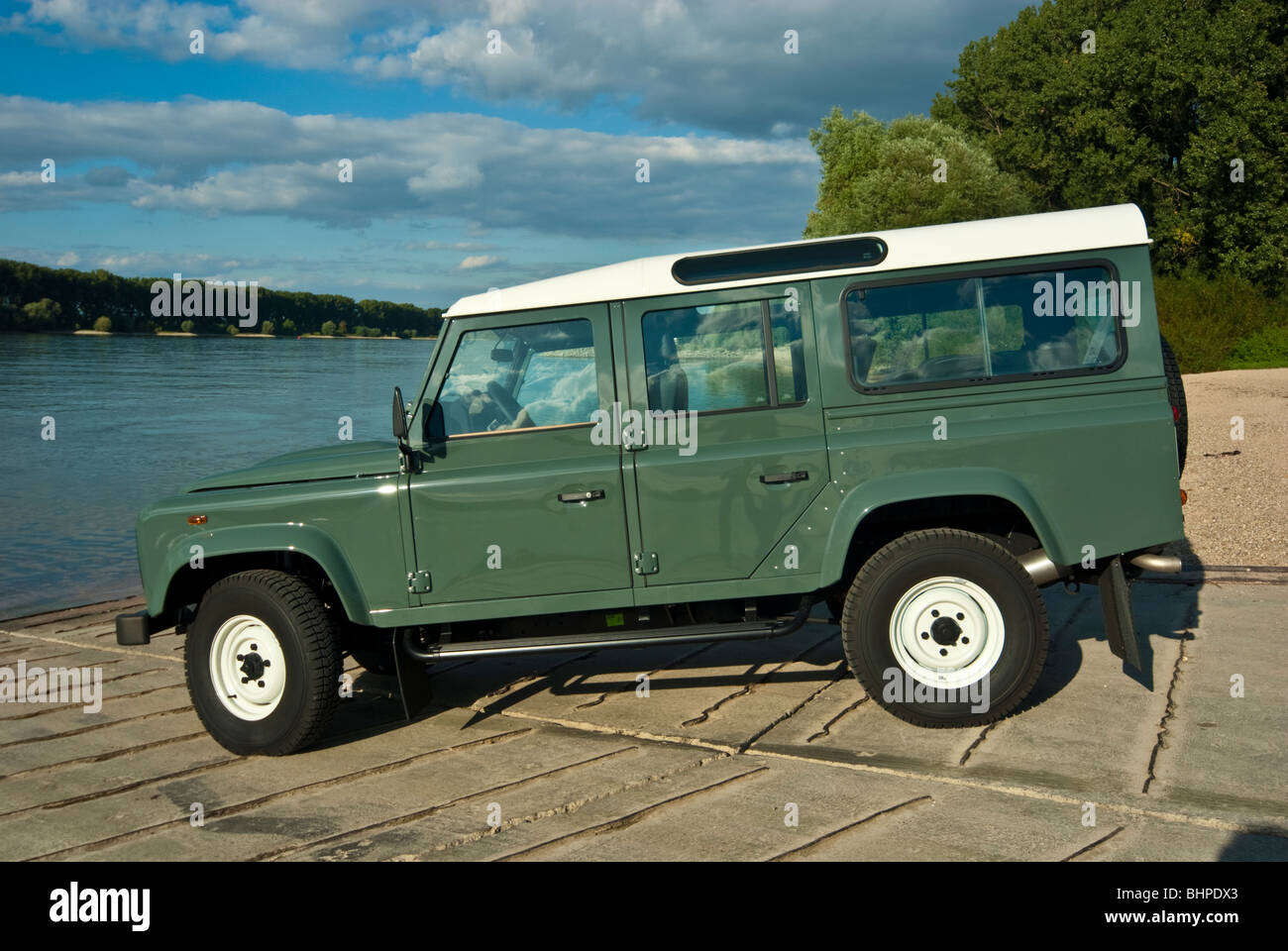 Side view of classical Land Rover Defender 110 off road ...