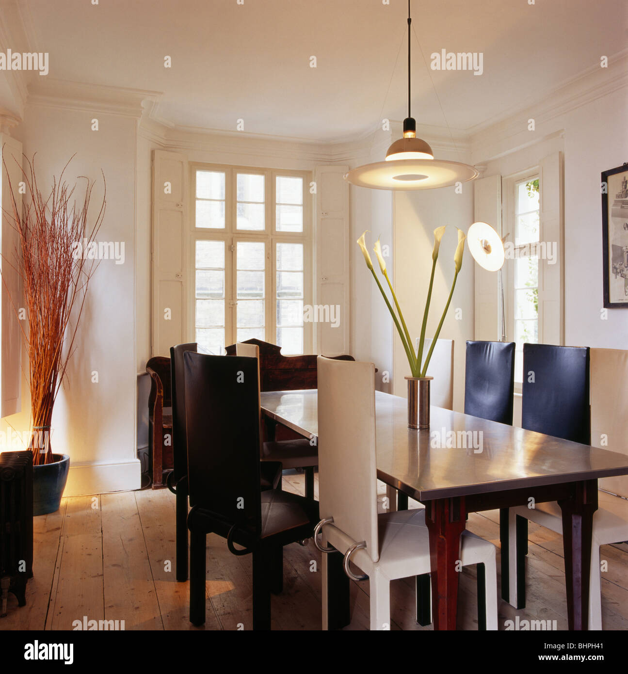 Pendant Light Above Oak Table And Black And White Leather