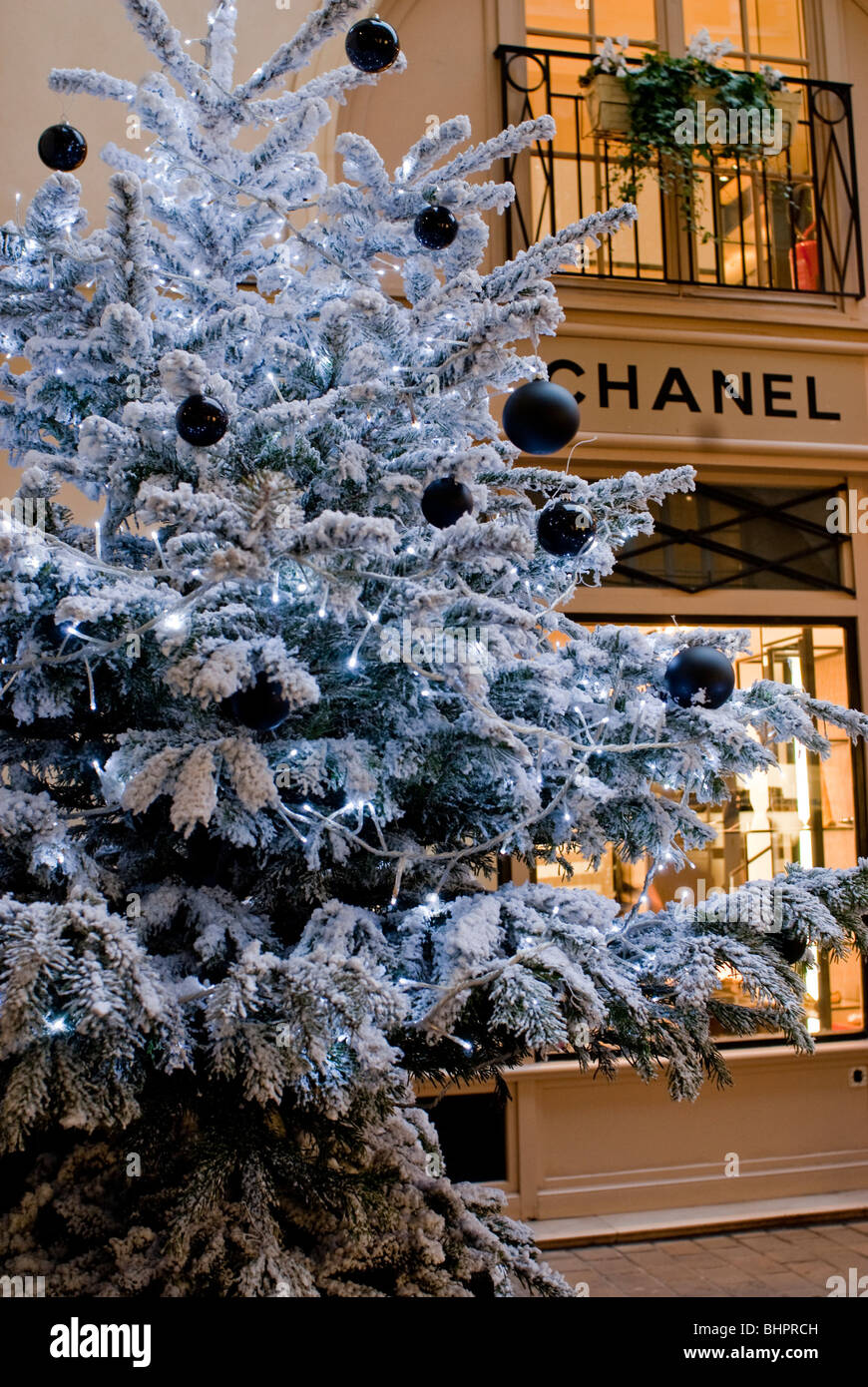 paris france christmas lights black tree ornament christmas trees on display at le village royal chanel store - Christmas Lights Store