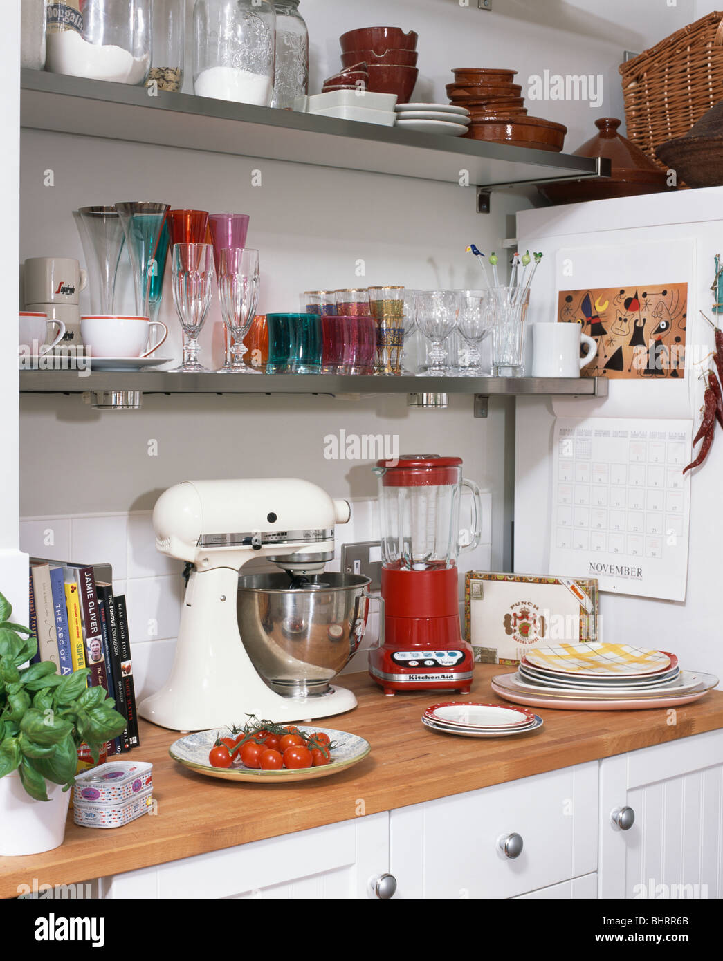 White Kitchenaid Mixer close-up of red kitchenaid blender and white kitchenaid mixer on