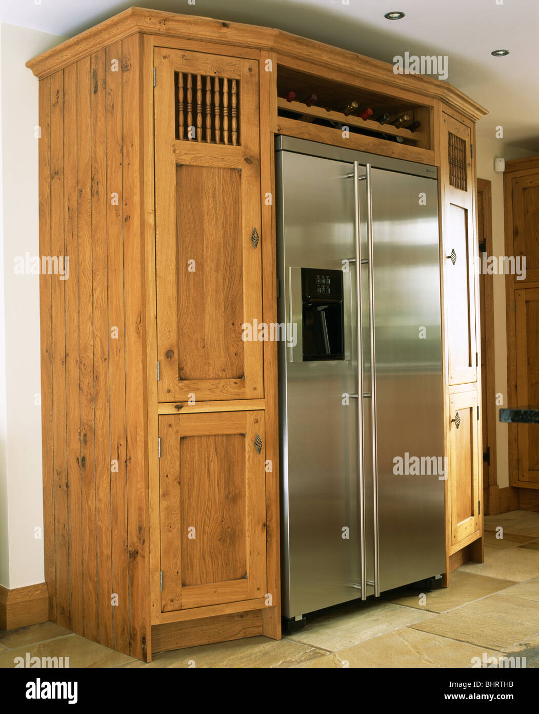 Large Stainless Steel American Style Fridge Freezer Built Into Fitted Oak  Storage Cupboard In Modern Kitchen