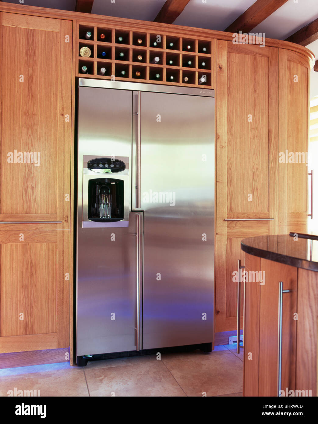 Large American Style Stainless Steel Fridge Freezer In Fitted Storage Unit  With Integral Wine Rack In Modern Kitchen