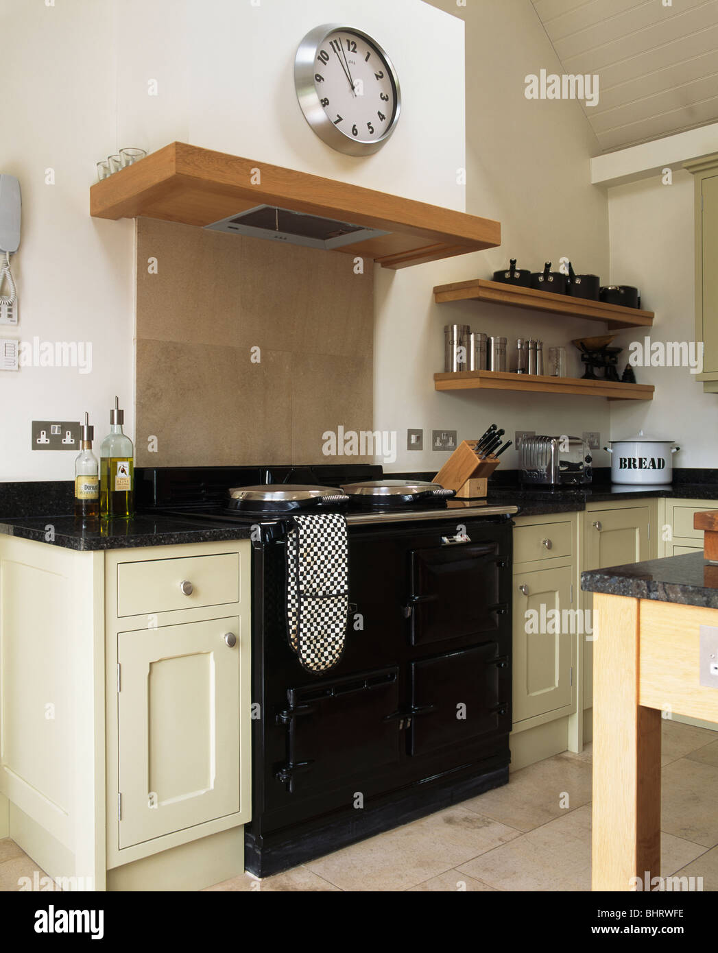 Black Country Kitchen circular stainless steel clock above black aga oven in modern