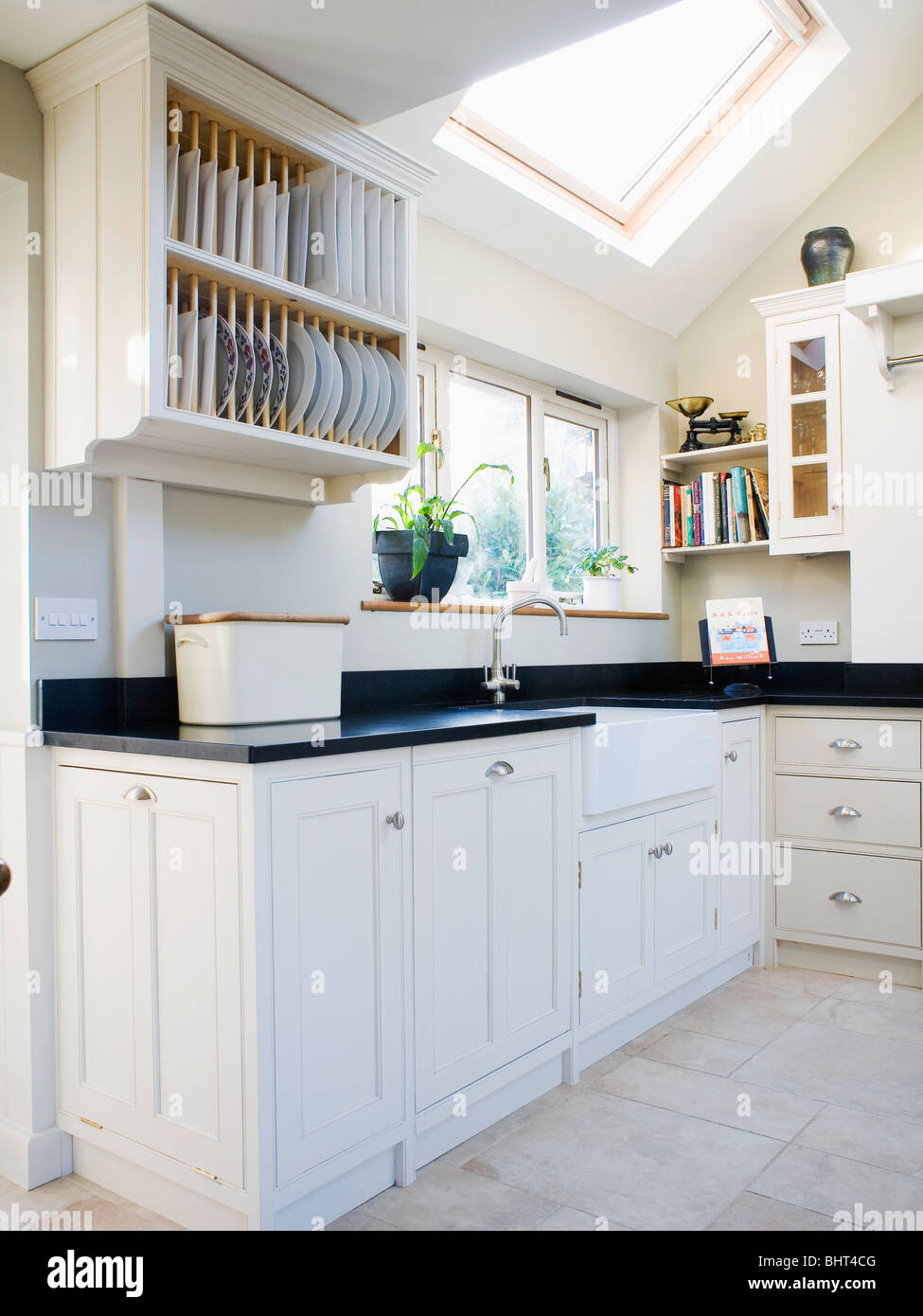 White Kitchen Units Black Worktop plate rack above fitted unit with black granite worktop in modern