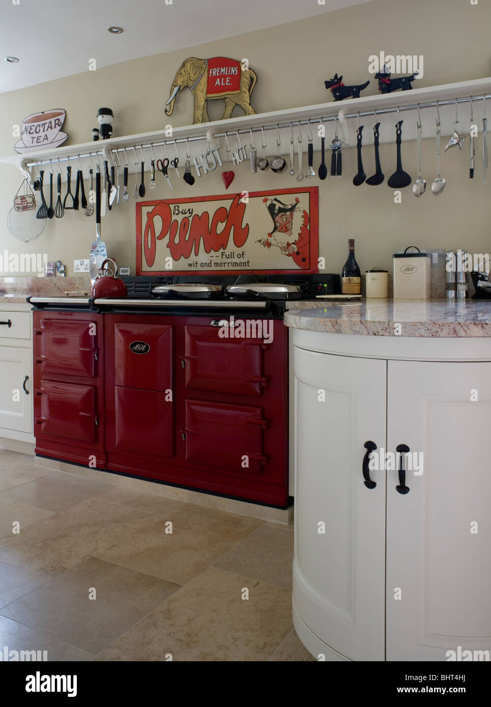 utensils on long shelf above red double aga oven in modern country kitchen utensils on long shelf above red double aga oven in modern country      rh   alamy com