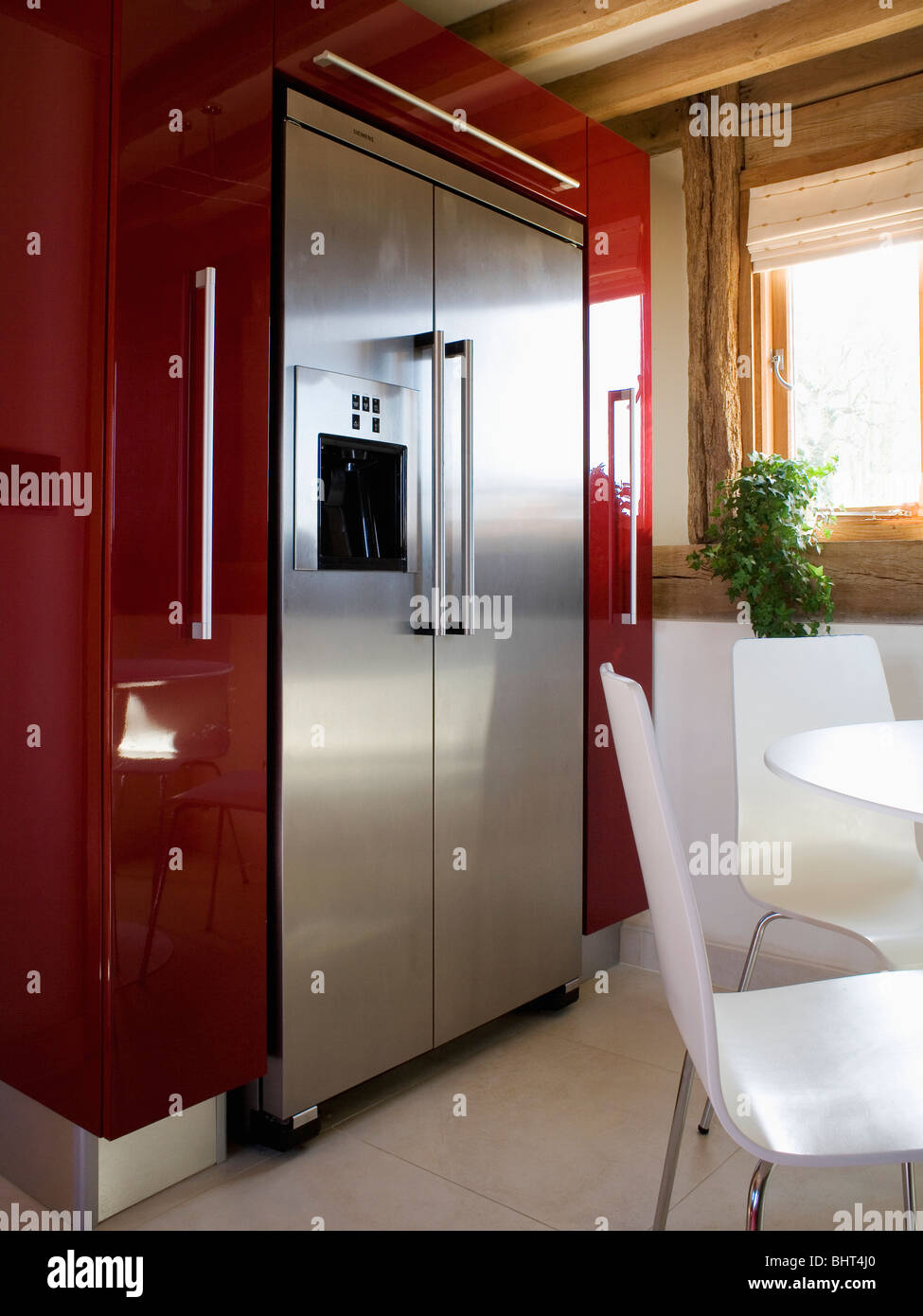 American style kitchen and living room -  Large Stainless Steel American Style Fridge Freezer In Modern Kitchen Dining Room With