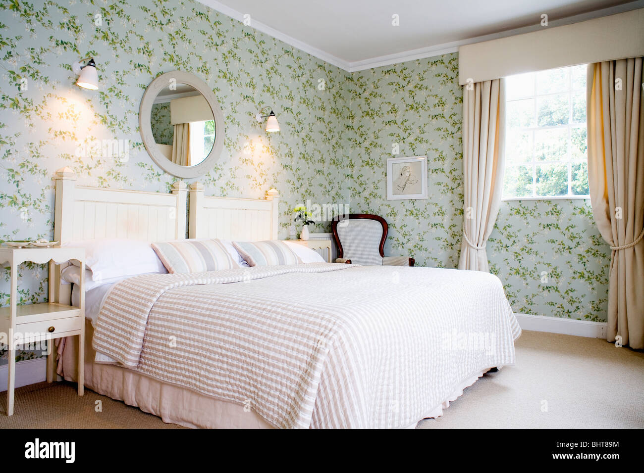 Lights On Wall Over Bed : Wall-lights above bed with cream bed-cover in traditional country Stock Photo, Royalty Free ...