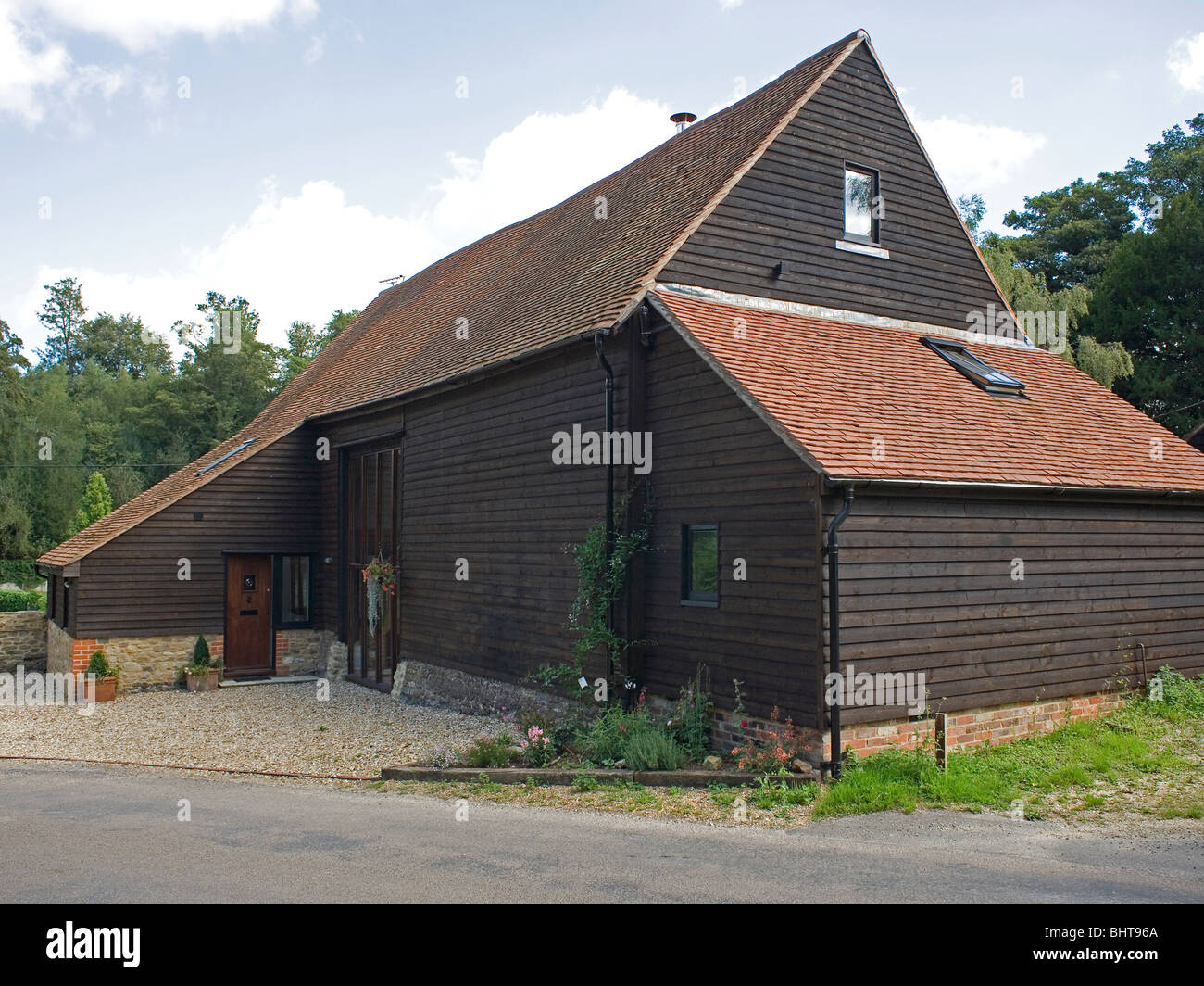 Barn Conversion exterior of a barn conversion with dark wood cladding stock photo