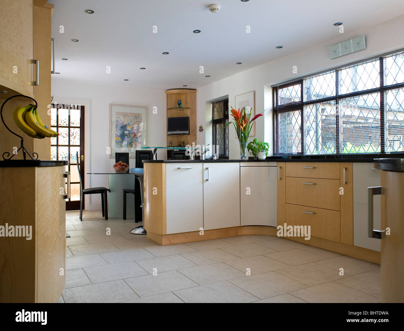 Limestone Floor Tiles In Modern Country Kitchen Dining Room Stock - Country kitchen tiles