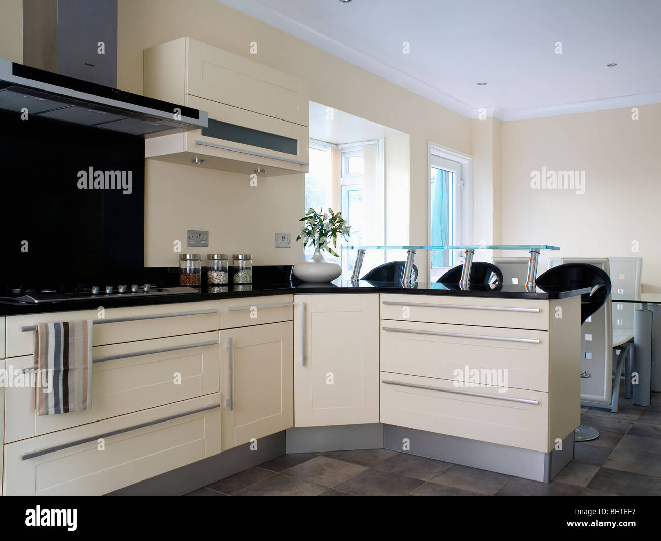 Cream fitted units in modern cream kitchen with small for Nice small kitchen units