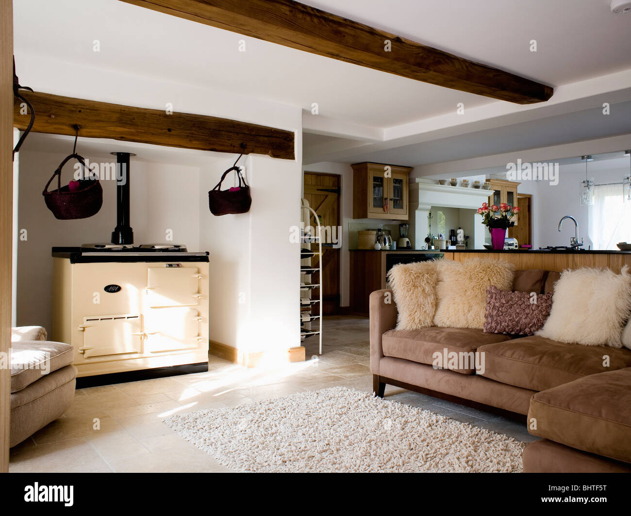 artificial fur cushions on brown suede sofa beside cream. Black Bedroom Furniture Sets. Home Design Ideas
