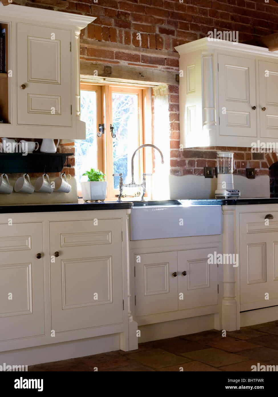 Belfast Sink Below Window In Country Kitchen With Ed Cream Units And Cupboards