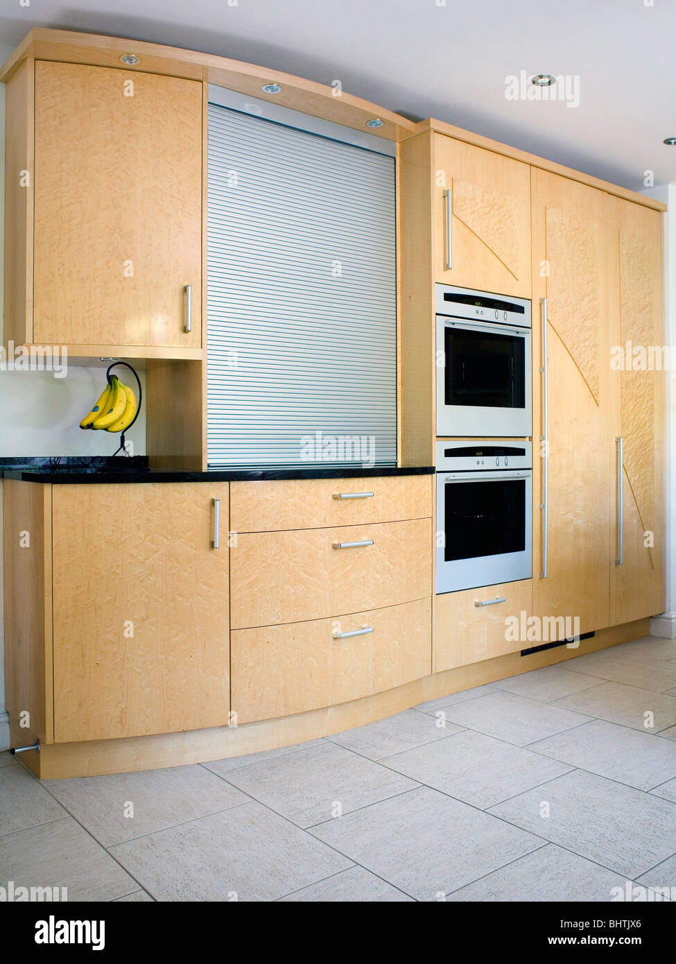 Fitted Kitchen Pale Wood Fitted Kitchen Cupboards And Units With Large Tambour