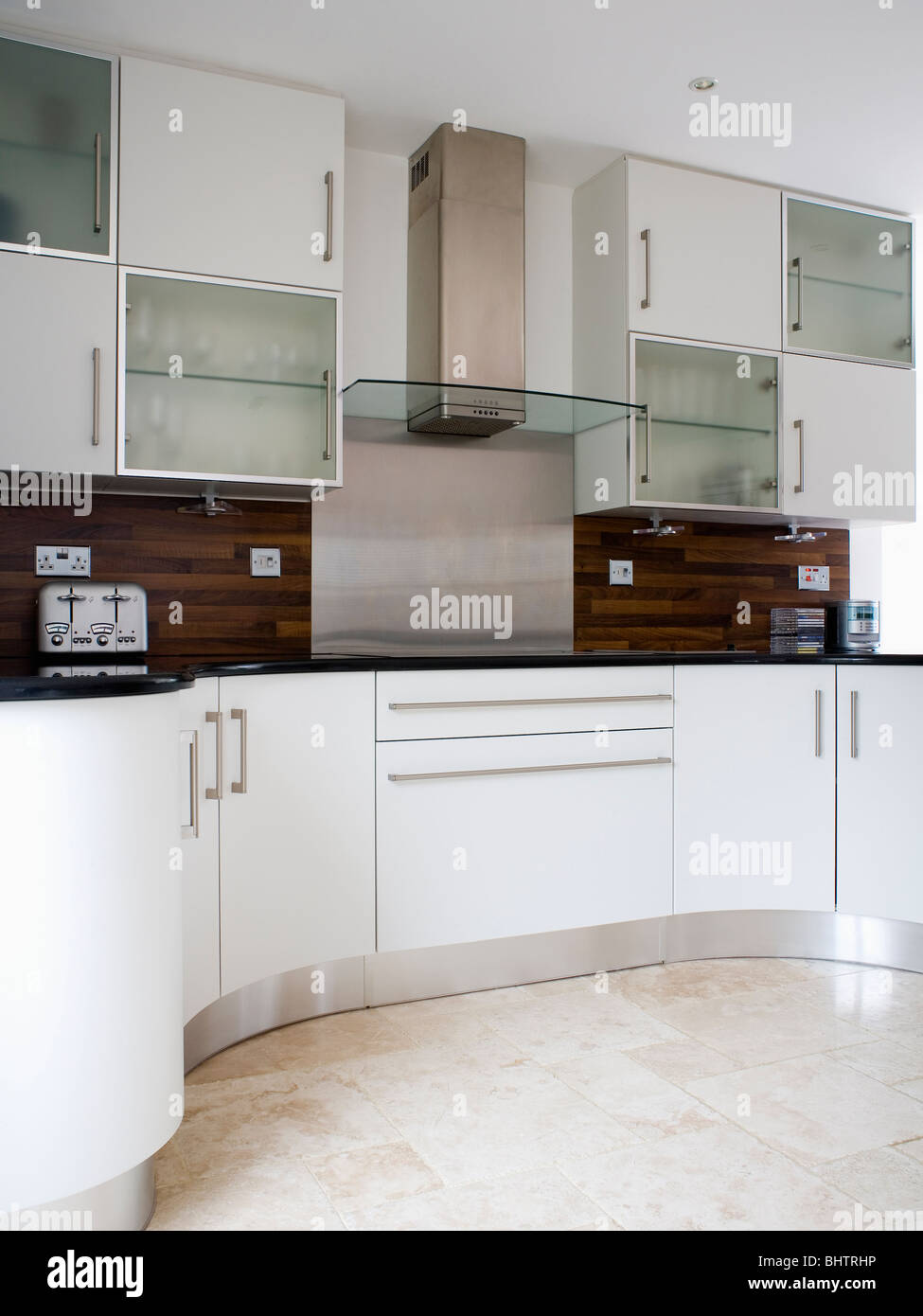 Modern kitchen with fitted white units and cupboards and for Fitted kitchen cupboards
