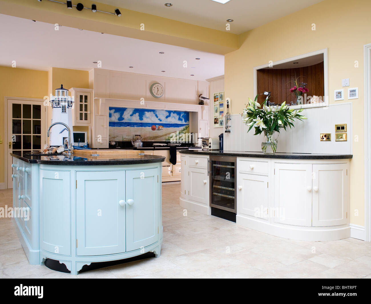Pastel Blue Island Unit In Large Pale Yellow Kitchen Extension With Fitted Cream Units