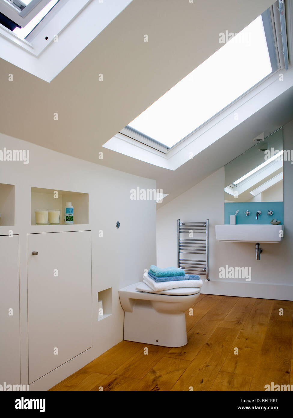 Velux Windows In Modern White Loft Conversion Bathroom