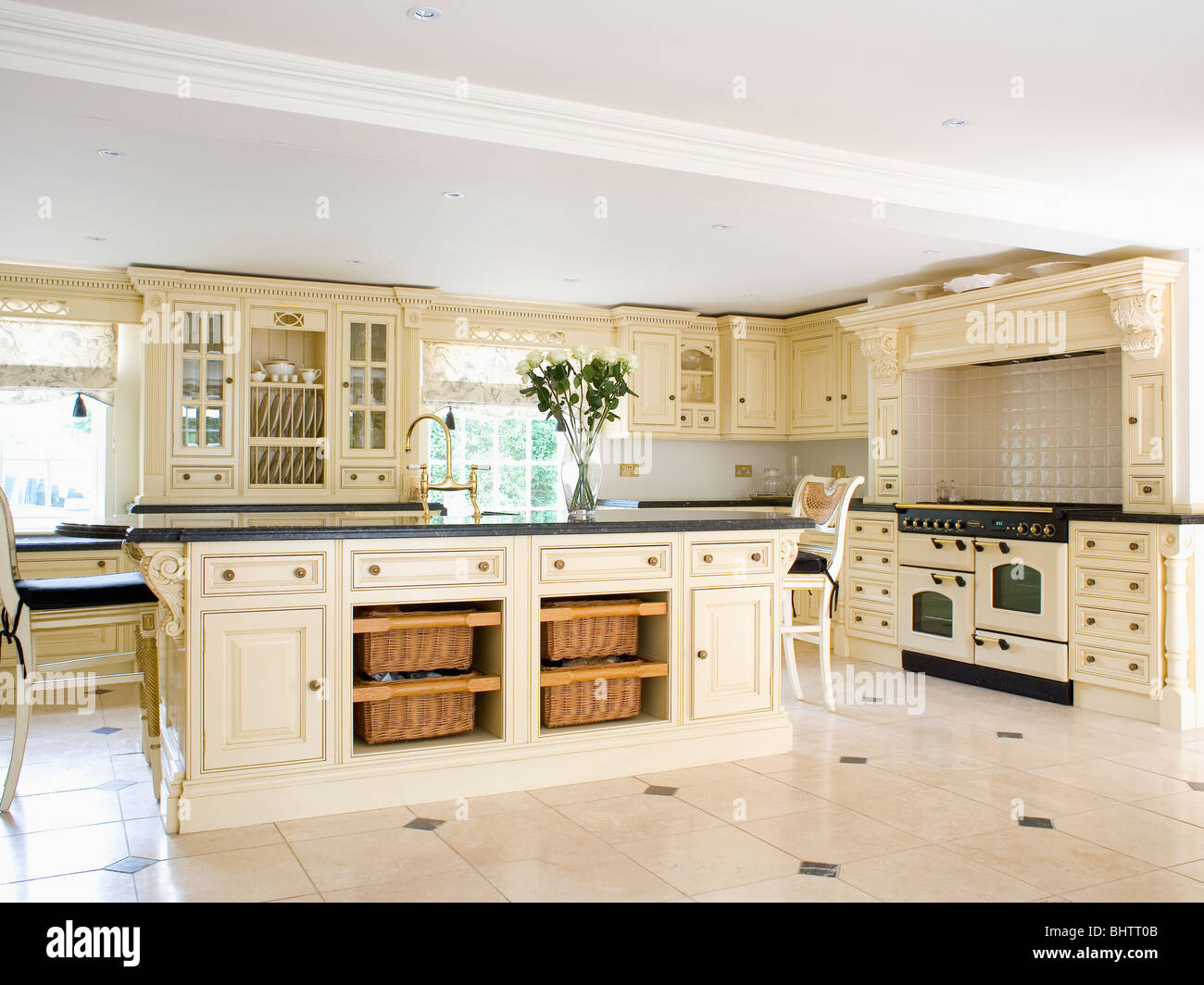 Stock Photo Storage Baskets On Shelves On Island Unit In Large Cream Country Kitchen